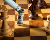 Chess with dollar and euro bill. dollar depreciati — Stock Photo