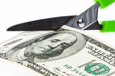 Dollar currency notes and scissors — Stock Photo