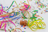 Champagne corks and garlands in the carnival and c — Stock Photo