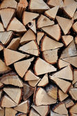 Stacked firewood on a pile of wood — Stock Photo