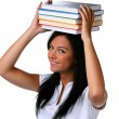Stock Photo: Young Woman with a pile of books on head