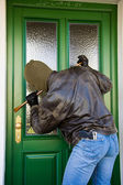 Burglar breaks into a residential building. — Stock Photo
