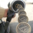 Gas nozzle pouring money — Stock Photo