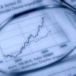 Stock Photo: Close up of stock market chart, glasses