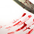 A knife smeared with blood — Stock Photo