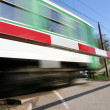 railroad crossing with high speed train — Stock Photo