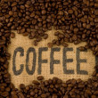 Label coffee on burlap and coffee beans   — Stock Photo