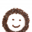 Smile made of coffee beans - Stock Photo