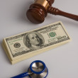 Stethoscope, Law gavel and us dollars — Stock Photo
