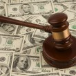 Law gavel on a stack of American money. — Stock Photo #8357879
