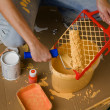 Pouring paint into a tray — Stock Photo #8358172