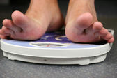 Female feet on scales — Stock Photo
