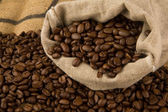 Coffee beans and bag — Stock Photo