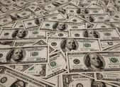 背景のドル紙幣のヒープ — ストック写真