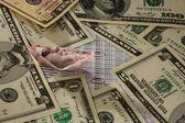 łódź z pieniędzy i dolar banknotów — Zdjęcie stockowe
