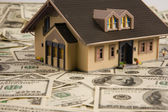 House on dollar bills — Stock Photo