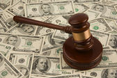 Law gavel on a stack of American money. — Stock Photo