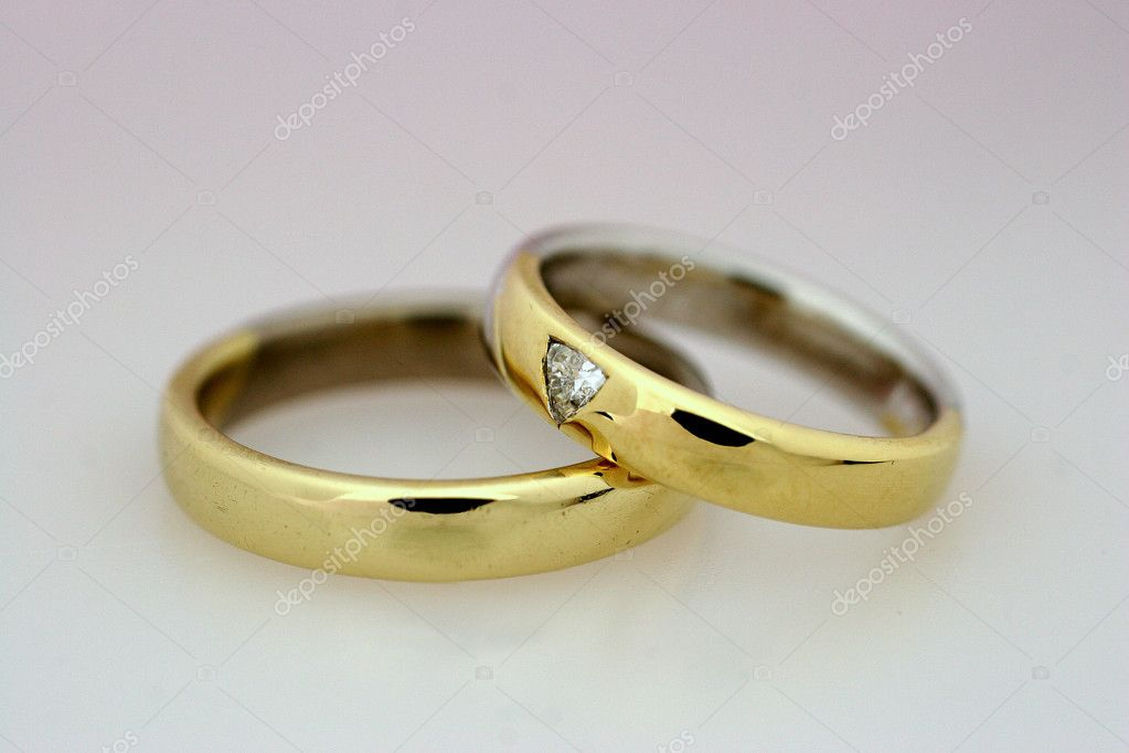 Two wedding rings on a grey background — Stock Photo #8356201