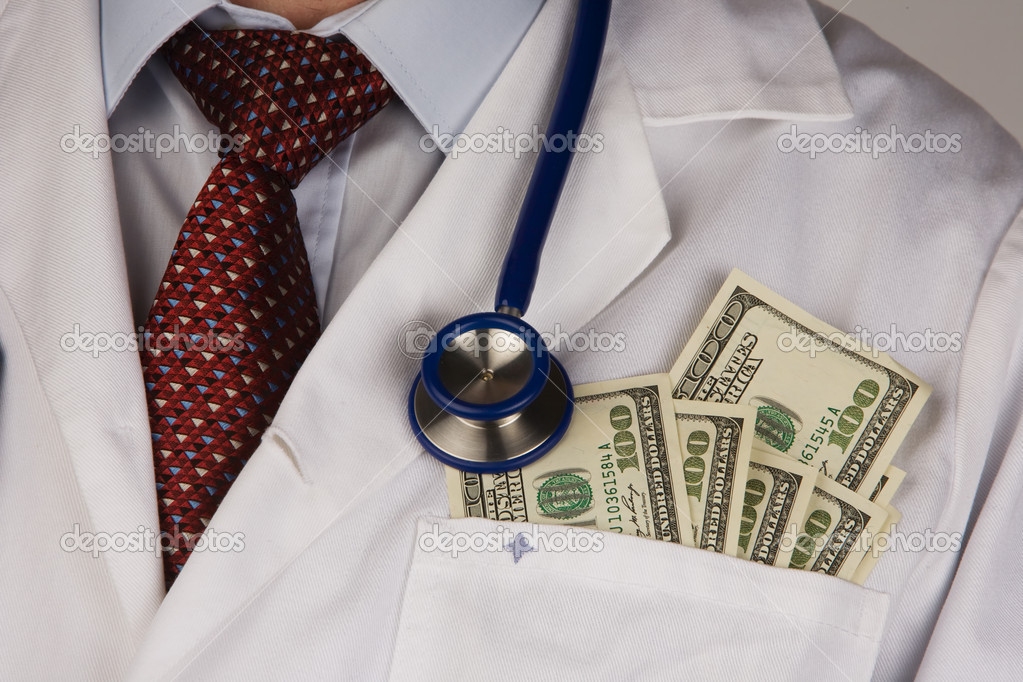 A doctor putting money in his pocket isolated on white background — Stock Photo #8357919