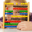School child is expecting an abacus — Stock Photo