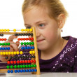 School child is expecting an abacus — Stock Photo #8360415
