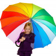 Child with a colorful umbrella — Stock Photo #8360449