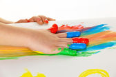 Child with finger paints colors — Stock Photo
