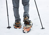 Senior when snowshoeing in winter — Stock Photo