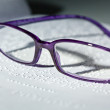 Glasses and book in braille. braille — Stock Photo #8421057