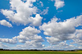 Blue sky with white clouds as background — Stock Photo