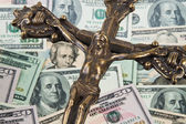 Dollar currency notes and cross — Stock Photo