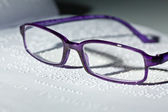Glasses and book in braille. braille — Foto Stock