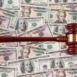 Stock Photo: Dollar currency notes with gavel.
