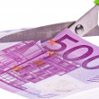 Euro banknotes and scissors — Stock Photo #8495016