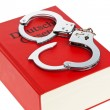 Gestzbuch and handcuffs — Stock Photo