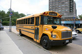 School bus traffic in the city of new york — Stock Photo