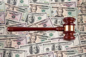 Dollar currency notes with gavel. — Stock Photo