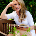 Woman reading a book in the garden — Stock Photo #8626336