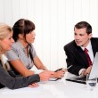 Successful team in a meeting — Stock Photo #8626417
