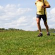 Stock Photo: Jogger training for fitness with running