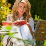 Woman reading a book in the garden — Stock Photo #8626613