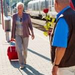 Mature senior couple at the train station — Stock Photo