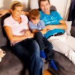 Family watching tv with tv — Stock Photo