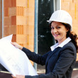 Architect with plan on construction site — Stock Photo #8626896