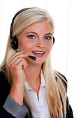 Woman with telephone headset in a call center — Stock Photo