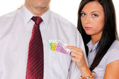 Woman pulls a man out of his pocket money — Stock Photo