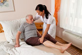 Nurse in elderly care for the elderly — Stock Photo
