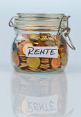 Flash with coins for pension provision — Stock Photo