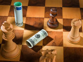 Chess with dollar and euro bill. — Stock Photo