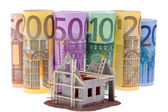 Euro bank notes with shell house — Stock Photo